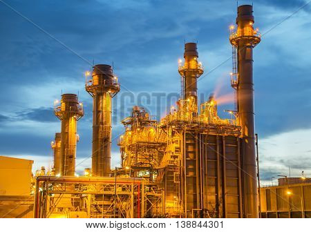 Oil refinery plant at twilight with sky background