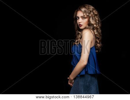 Stylish Portrait Of A Beautiful Girl On A Black Background. Blonde In Designer Clothes. Fashion Phot
