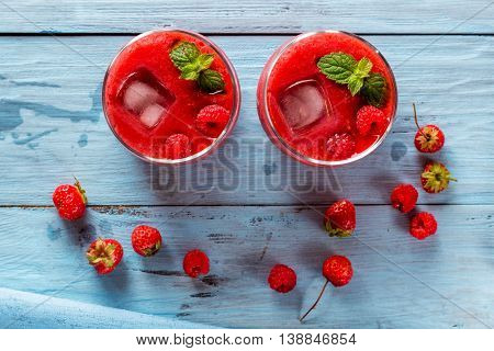 smoothie of strawberries and raspberries flat lay