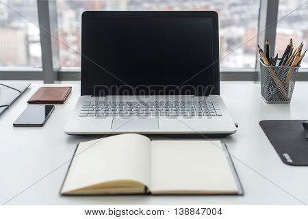 Work table, workplace with notebook laptop close up
