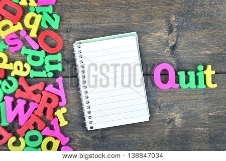 Quit word on wooden table