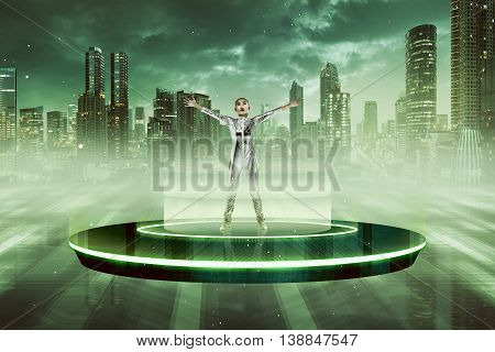 Woman in latex costume going to space with flying saucer. UFO concept