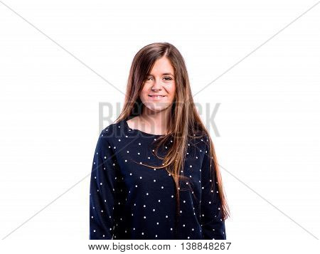 Teenage girl in dark blue dotted sweatshirt, young beautiful woman, studio shot on white background, isolated