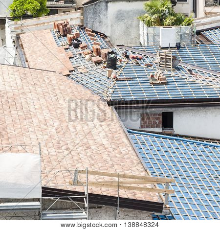Construction site. Roof renovation. Pallets of shingles