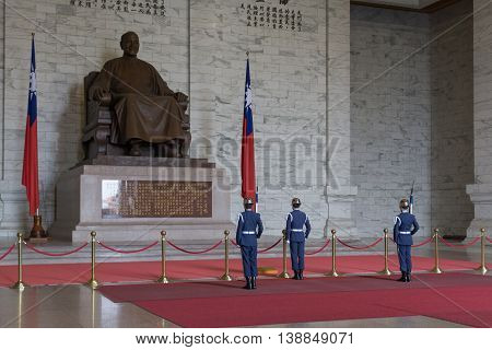 Taipei, Taiwan - January 08, 2015: Changing of guards procession inside Chiang Kai-Shek memorial hall.