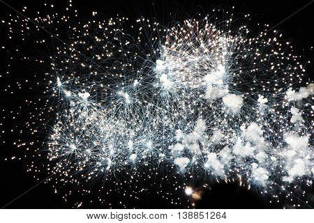 White fireworks on sky. International Fireworks. Fireworks display on dark sky background.