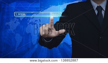 Businessman hand pressing search www button over map and city tower Searching system and internet concept Elements of this image furnished by NASA
