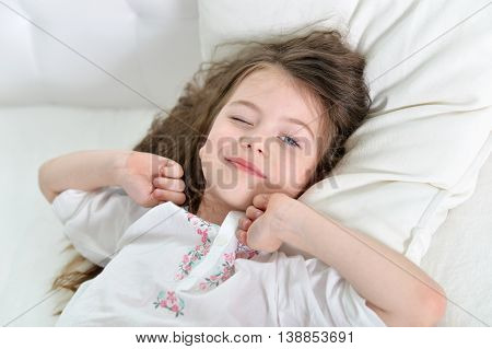 Adorable little girl awaked up in her bed