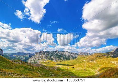 Montenegro national park Durmitor mountains and clouds. Sunlight lanscape