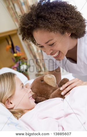 Nurse Laughing With Her Young Patient