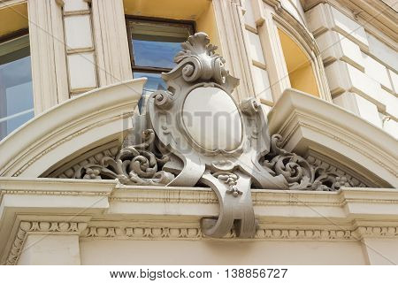 Сartouche with a empty convex shield on the facade of the building