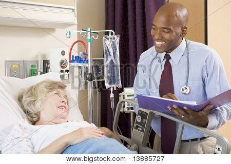 Doctor Making Notes About Patient