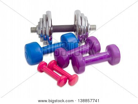 Several fixed weight dumbbells different weight and sizes coated with vinyl of various colors and one adjustable dumbbell on a light background