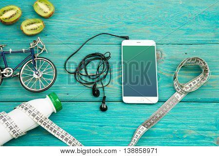 Bicycle Model, Headphones, Smartphone, Kiwi, Bottle Of Water And