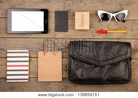 Women Set With Bag, Tablet Pc, Sunglasses, Notepad, Gift Box, Shopping Bag And Tag On Brown Wooden D