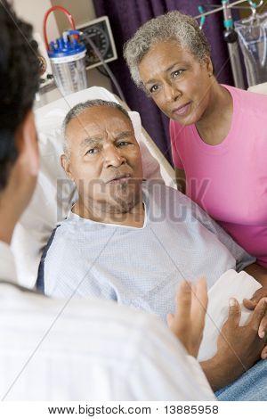 Senior Couple Talking To Doctor