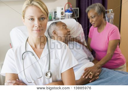 Doctor Standing In Hospital Room With Her Arms Folded