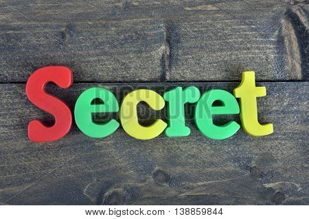 Secret  word on wooden table