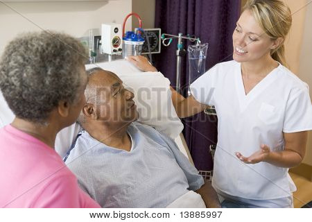 Doctor Explaining To Senior Couple