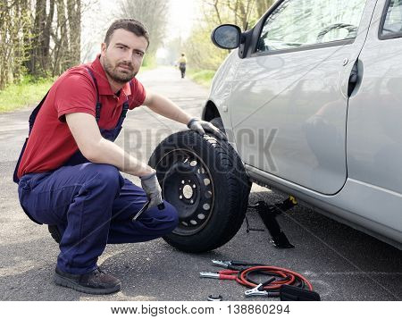 Man Fixing A Car Problem After Vehicle Breakdown On The Road