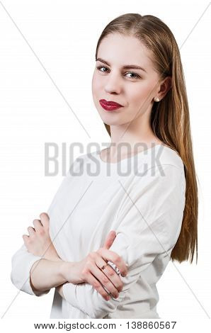 Young beautiful blond girl with crossed hands isolated on white