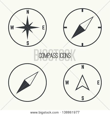 Set of vector icons with a compass and gps pointers.  The wind rose and compass arrow