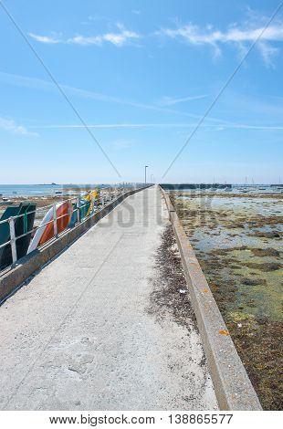 coastal scenery with long pier around Penmarch in the Finistere department in Brittany France