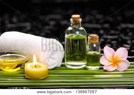 Spa set on long leaf with towel.massage oil