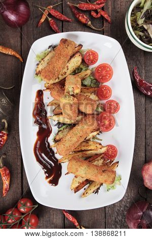 Breaded veggie sticks with roasted potato wedges