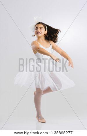 Beautiful little girl practicing ballet