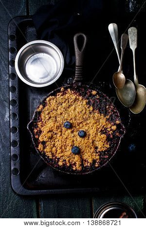 Crumble with a plum and berry. style vintage. top view. selective focus