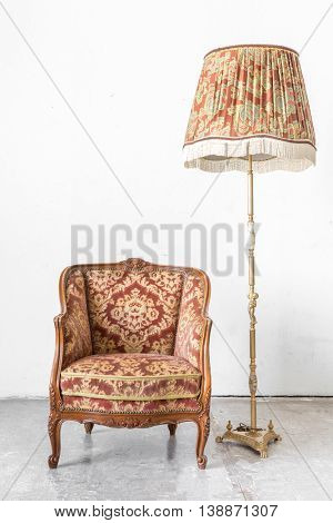Brown Classical style sofa in vintage room with desk lamp