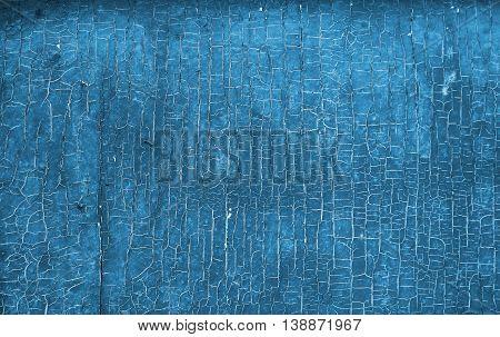 blue old peeling paint on old wall