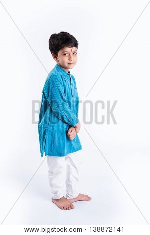 Happy indian boy wearing traditional Indian dress and standing