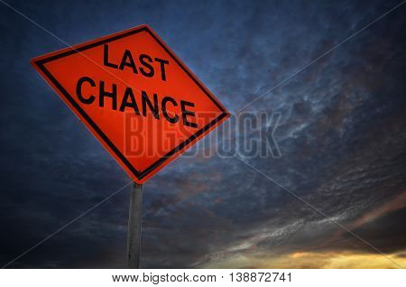 Last chance warning road sign with storm background