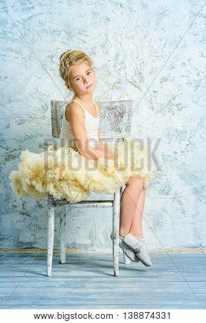 Beautiful young ballet dancer posing in studio.
