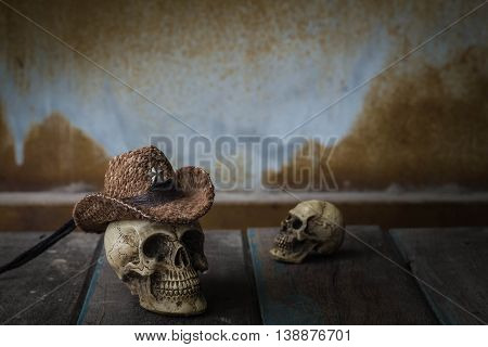 Skull cap on the old wooden table.