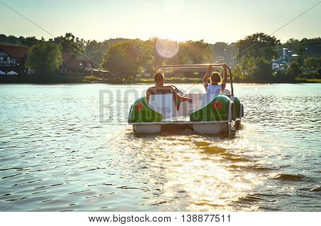 Ilawa-Poland June 2016. The couple on the pedal boat on the lake Jeziorak in Poland. Editorial photo