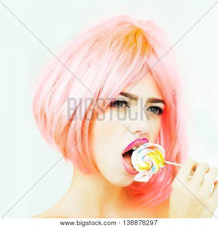 Woman With Orange Hair Lick Lollipop