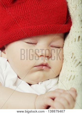 The sweet dream of baby in red hat
