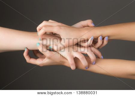Four Female Hands Touching