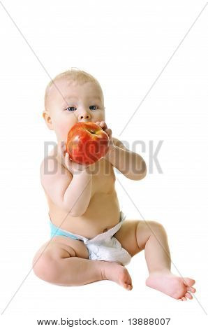 little girl eat ripe red apple