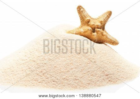 Starfish On Pile Of Beach Sand Isolated On White