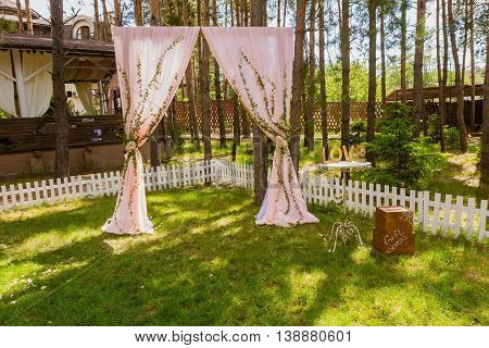 Beautiful wedding arch for ceremony in the park