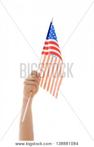 Hand holding American flag on white background