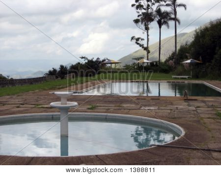 Fountain And Pool Reflection