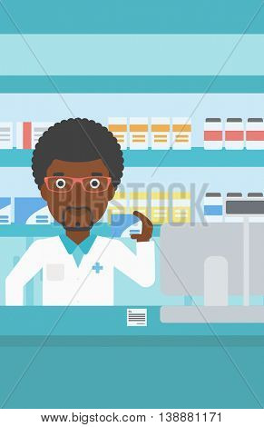 An african-american young pharmacist standing at the counter and showing a box of pills in the pharmacy. Vector flat design illustration. Vertical layout.