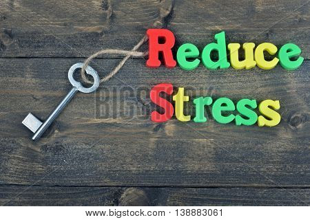 Reduce stress word on wooden table