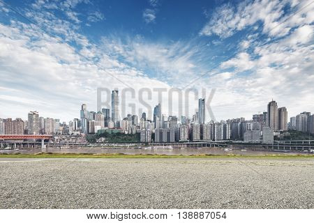 cityscape and skyline of chongqing in cloud sky on view from empty ground
