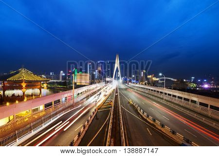 busy traffic on bridge near downtown of chongqing at twilight